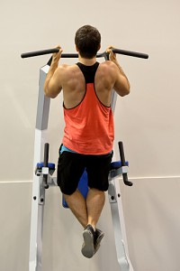 Full length view of a male doing pull ups